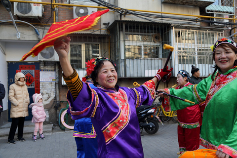 Residents of Beijing's suburban Mentougou district dress up and dance to celebrate Xiao Nian on Monday. Photo: VCG
