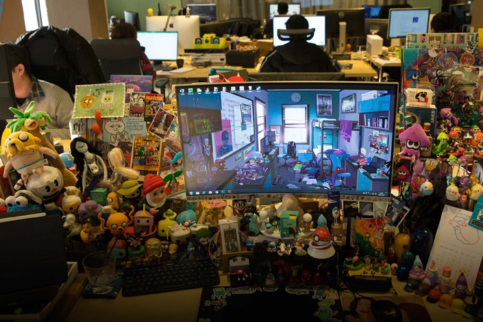 A game graphic designer's desk at Coconut Island Games Studio in Shanghai, Jan. 15. Photo: Shi Yangkun/Sixth Tone