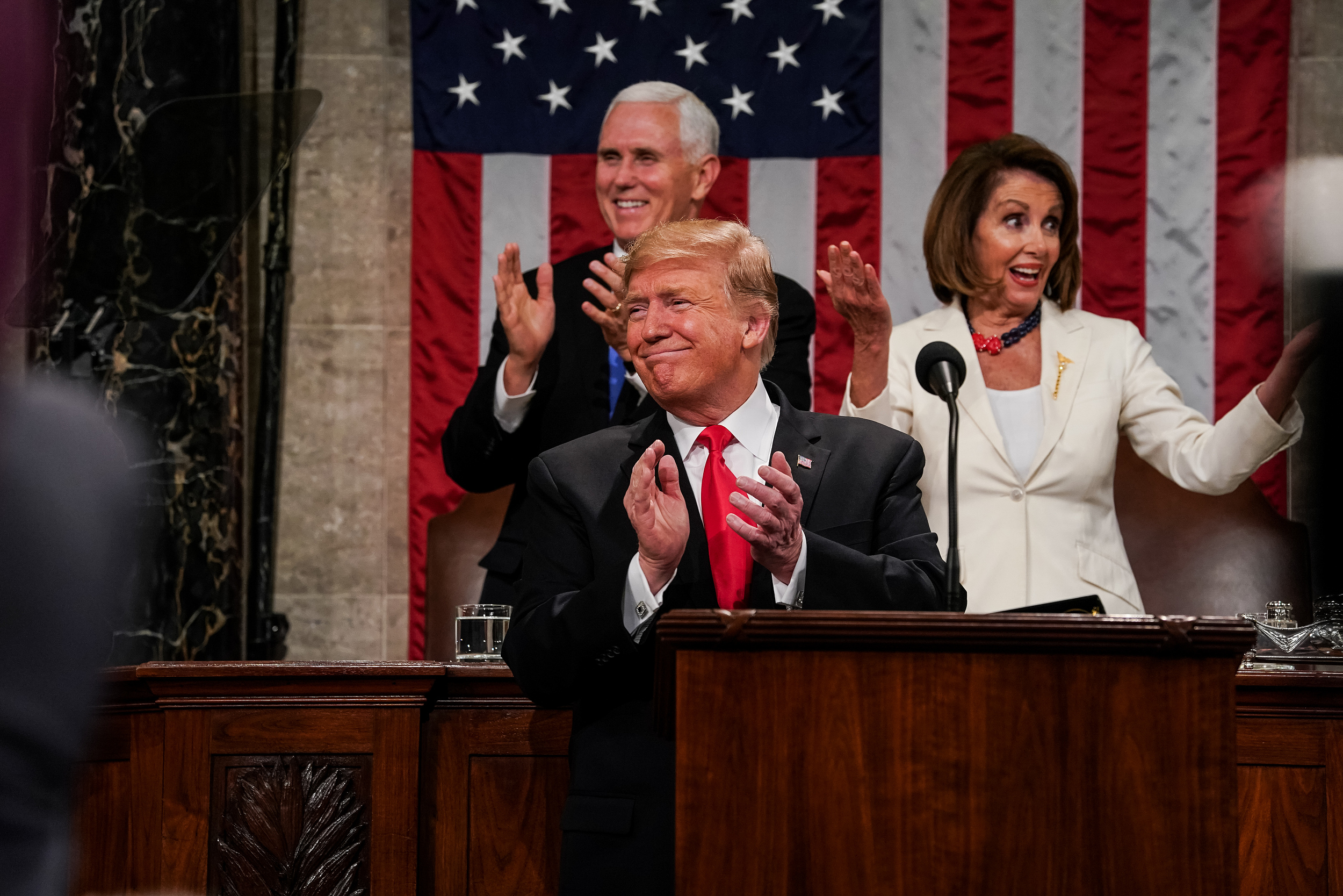 President Donald Trump, Speaker Nancy Pelosi and Vice President Mike Pence applaud during the State of the Union address in the chamber of the U.S. House of Representatives at the U.S. Capitol Building on Feb. 5 in Washington, DC.