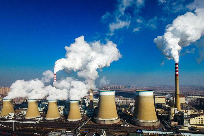 Chimneys belch smoke at a coal-fired power plant in North China's Shanxi province on March 17, 2018. Photo: IC