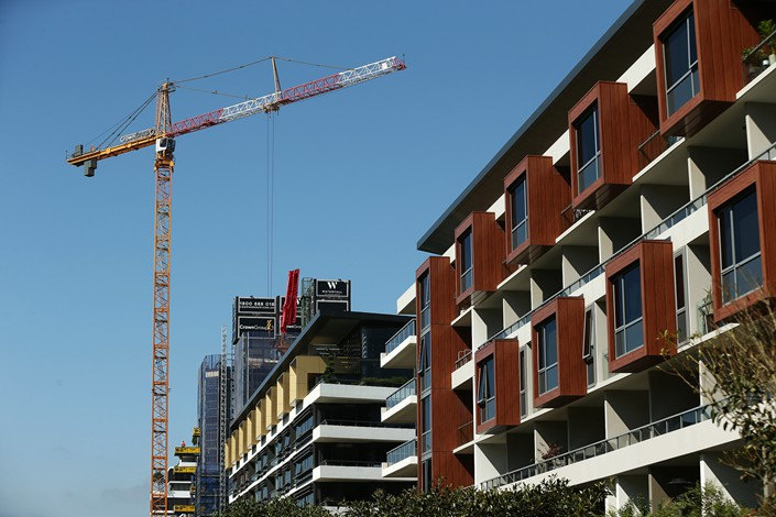 A crane stands next to residential buildings in the Green Square area of Sydney, Australia, on Jan. 12. Photo: VCG