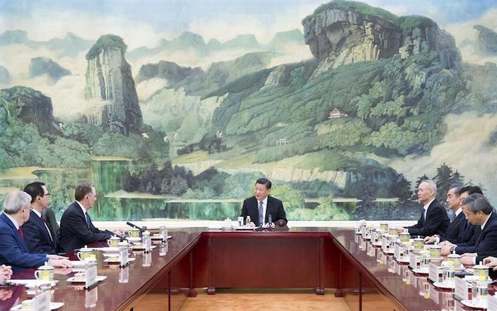 Xi meets with China and U.S. trade delegations Friday at Beijing's Great Hall of the People. Photo: Xinhua