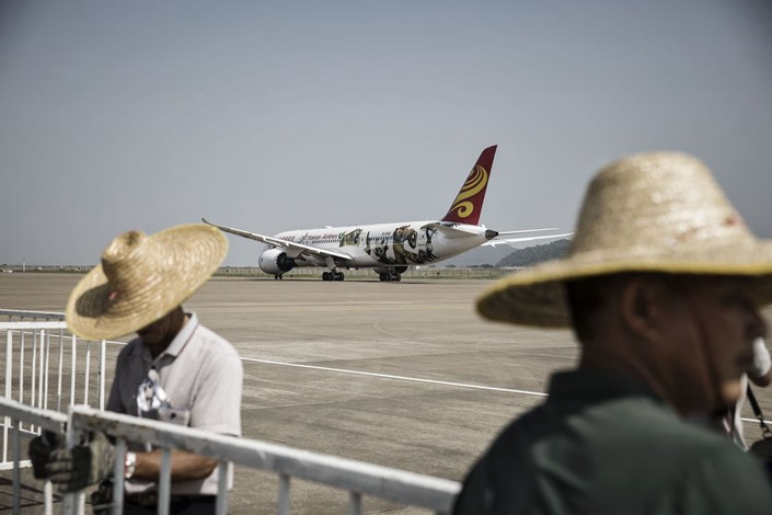 The Chinese group, which grew out of an airline on tropical Hainan island, is seeking to trim one of China's biggest debt piles. Photo: Bloomberg