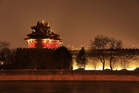 A yellow light highlights the wall and tower of the Palace Museum on Monday night. Photo: VCG