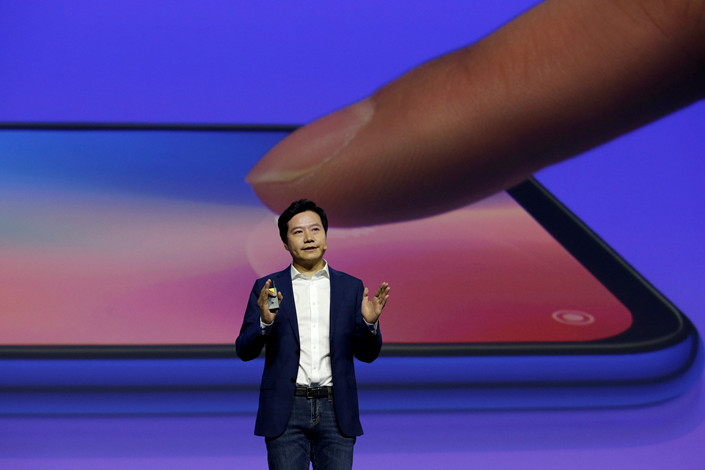 Xiaomi CEO Lei Jun attends a launch ceremony of the company's new flagship phone, the Mi 9, in Beijing on Wednesday. Photo: VCG