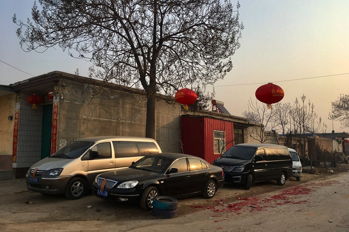 New cars parked in a rural street in Hebei province during the Lunar New Year in February. Photo: VCG