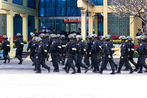 Armed police officers walk outside the Dong Dang railway station in Hanoi on Monday, the day before Kim Jong Un arrived in the Vietnamese capital. Photo: IC