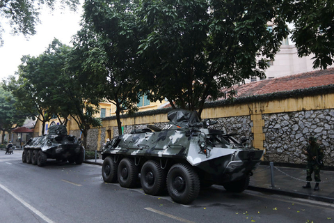 Two armored vehicles parked Tuesday near the Melia Hotel, where Kim Jong Un will stay during his visit to Hanoi. The building they are parked beside is the Hoa Lo Prison Memorial, a former prison famous for housing U.S. prisoners of war, including the late Senator John McCain, during the Vietnam War. Photo: VCG