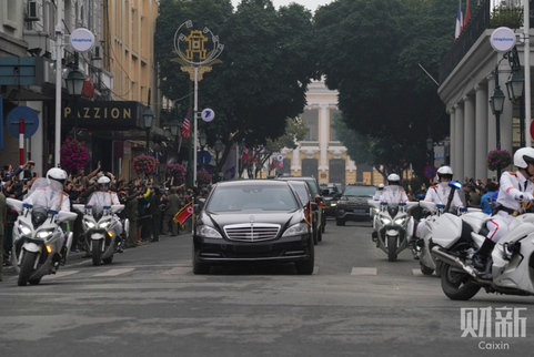 Cars carrying North Korea's leader Kim Jong Un and his team drive past the Hanoi Opera House in Hanoi, Vietnam on Tuesday. Photo: Caixin/Liang Yingfei