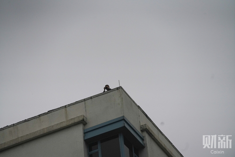 A security guard stationed on the roof of the Melia Hotel, where Kim Jong Un will be staying while he is in Hanoi. Photo: Caixin/Liang Yingfei