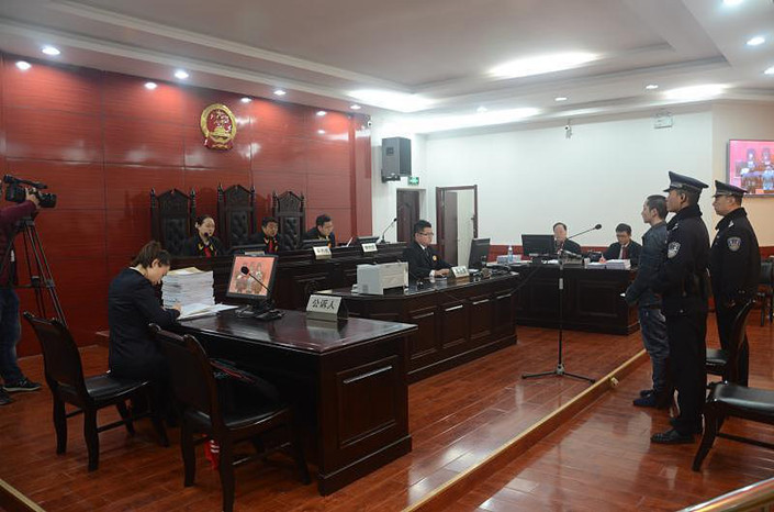 A fraud case which took in 27 college students and 490,000 yuan is heard in Xi'an Intermediate People's Court on Nov. 17, 2017. Photo: VCG
