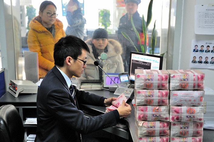 Large state-controlled banks are required to increase their loans to small enterprises by more than 30% this year, the CBIRC has said in a notice. Photo: VCG