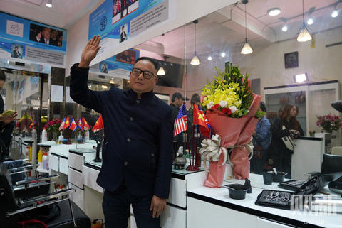 A man poses after having his hair cut to resemble North Korean leader Kim Jong Un in Hanoi, Vietnam, on Feb. 26. In the past two weeks, over 600 customers have flocked to this hair salon from all over the Vietnam to get Kim's signature look for free. Photo: Caixin/Liang Yingfei