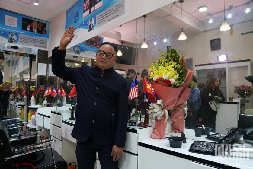A man poses after having his hair cut to resemble North Korean leader Kim Jong Un in Hanoi, Vietnam, on Feb. 26. In the past two weeks, over 600 customers have flocked to this hair salon from all over the Vietnam to get Kim's signature look for free. Photo: Caixin/Liang Yingfei_Gallery: Hanoi Gears Up for Trump-Kim Summit With Haircuts, Hamburgers