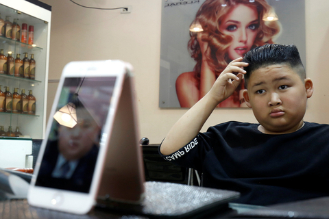 To Gia Huy, 9, takes in his new Kim Jong Un-style haircut at a salon in Hanoi, Vietnam, on Feb. 20. Photo: IC