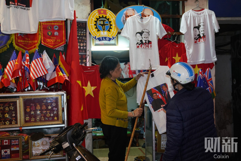 T-shirts celebrating the Trump-Kim summit are displayed outside a shop in Hanoi on Feb. 26. Photo: Caixin/Liang Yingfei