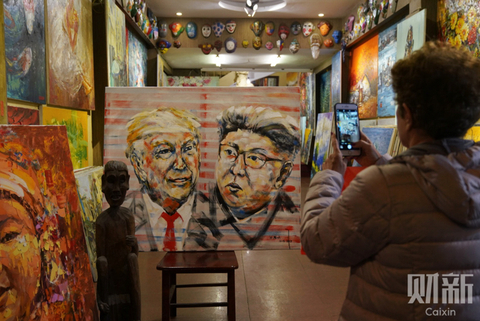A $250 portrait of U.S. President Donald Trump and North Korean leader Kim Jong Un at a gallery in Hanoi on Feb. 26. Photo: Caixin/Liang Yingfei