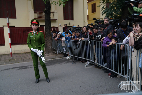 A police officer stands in front of journalists across the road from the North Korean embassy in Hanoi on Tuesday, on Feb. 26. Photo: Caixin/Liang Yingfei