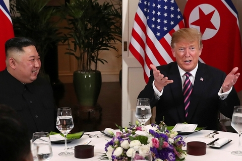 Trump and Kim sit down to dinner on Wednesday. Photo: VCG