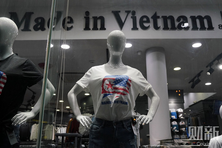 Mannequins wearing T-shirts celebrating the forthcoming Trump-Kim summit on display in Hanoi on Feb. 26. Photo: Liang Yingfei/Caixin