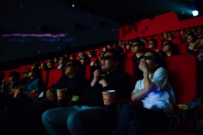 People watch a movie at Wanda Group's Oriental Movie Metropolis in Qingdao, Shandong province. Photo: VCG
