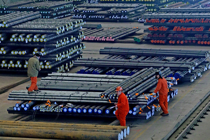 Workers prepare steel products for sale in the northeastern city of Dalian on Jan. 7. Photo: VCG