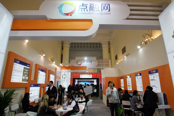 People visit Dianrong's stand during an exhibition in Shanghai in November 2013. Photo: IC