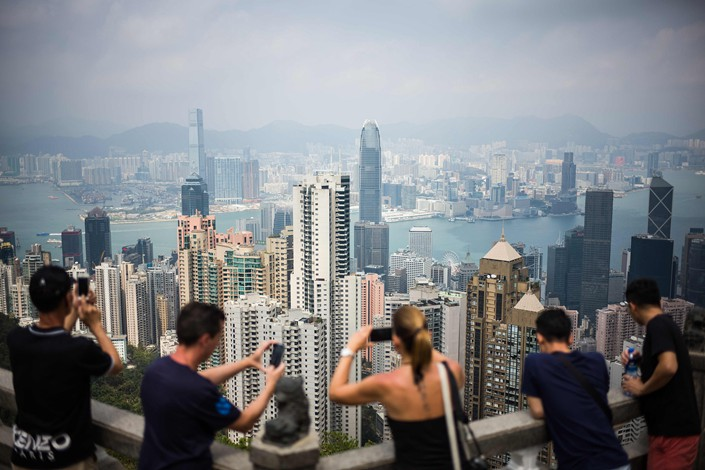 Tourists take photos of Hong Kong's skyline from Victoria Peak on Sept. 27. Photo: VCG