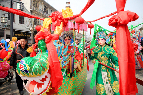 A performer sits in a dragon carriage during the parade in Huaxian on March 5. Photo: VCG