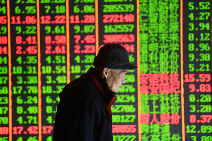 A trader in the city of Hangzhou looks on as China's stocks post worst drop in five months, reflected by green for falling stocks. Photo: VCG