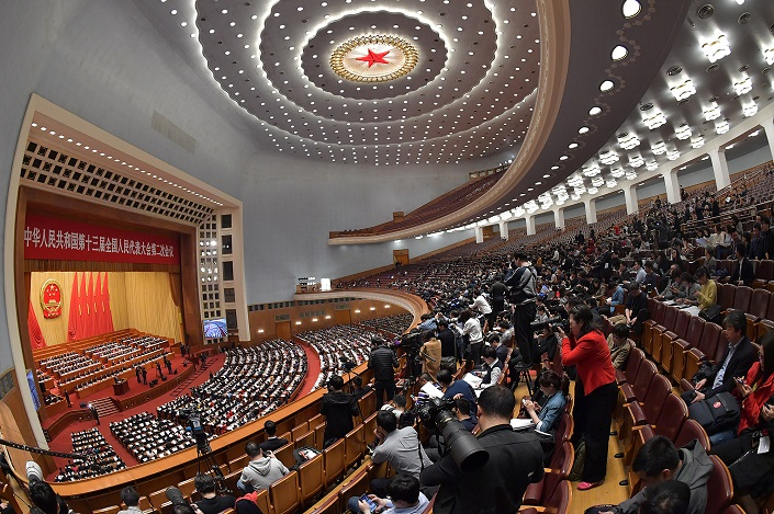China's National People's Congress holds a second reading of the draft Foreign Investment Law on March 8. Photo: VCG