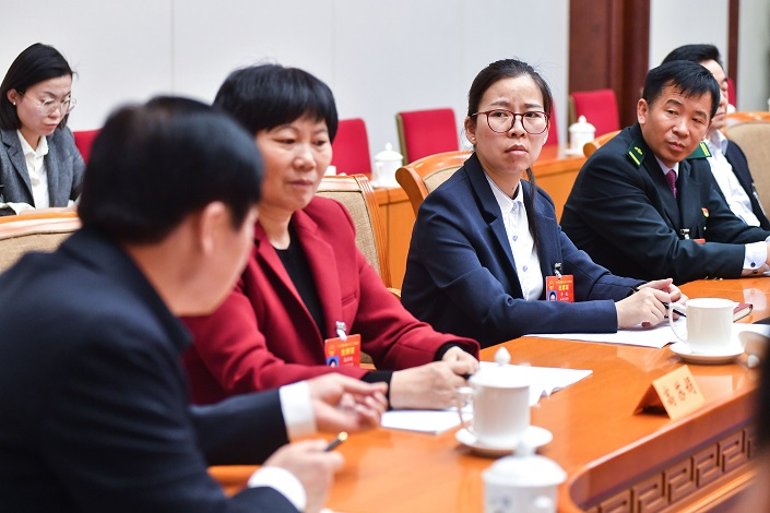 NPC delegates from China's Jiangsu province participate in a small-group discussion on the draft Foreign Investment Law on March 10. Photo: VCG