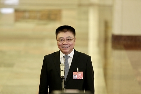Housing minster Wang Menghui answers questions at this year's