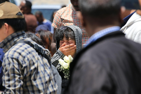 A relative of a Chinese victim of the Ethiopian Airlines crash cries as she arrives at the crash site in the Oromia region of Ethiopia on Wednesday. Photo: VCG