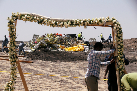 Local officials set up an arch of flowers to receive victims' families for a commemoration ceremony at the crash site in Ethiopia on Wednesday. Photo: VCG