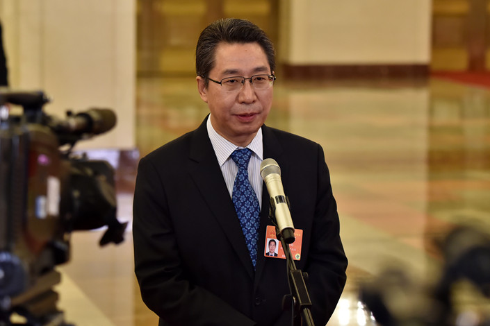 Shen Changyu, director of the state intellectual property office, speaks to the media in the Great Hall of the People in Beijing on March 12. Photo: VCG