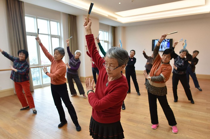 Residents of a Beijing community for the elderly take a dance class on Dec. 5. Photo: VCG