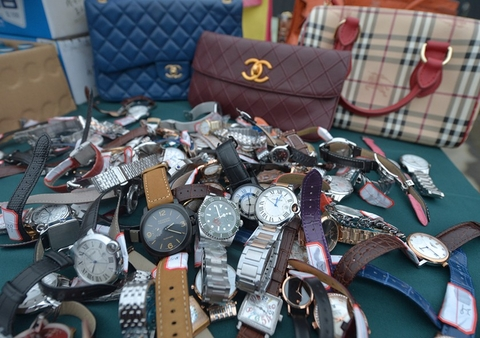 The Public Security Bureau of Chengdu, Sichuan province and the local Market Supervision Administration on March 13 destroyed counterfeit products including fake Burberry and Chanel bags, and knockoff Rolex watches. Photo: VCG