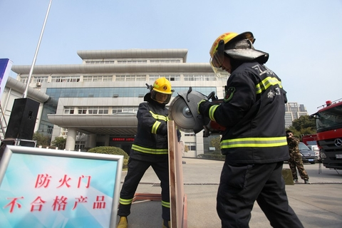 Firefighters in Yangzhou, Jiangsu province destroy counterfeit firefighting products such as fake fire extinguishers and emergency lighting equipment on March 14. Photo: VCG