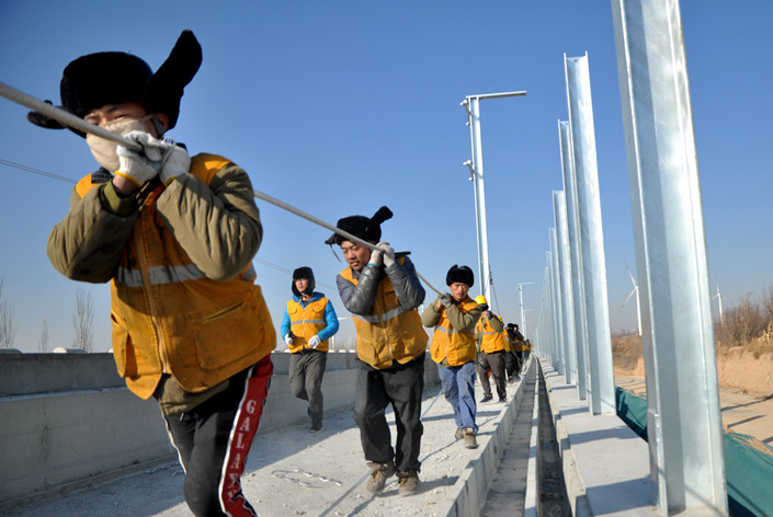 Workers prepare to lay a high-speed rail line from Beijing to the nearby city of Zhangjiakou, Hebei province, on Nov. 26. Photo: IC