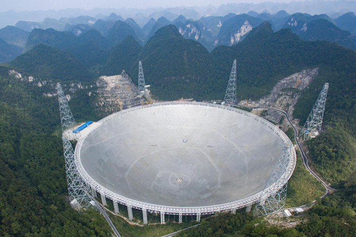 An aerial view in June 2016 of the nearly completed FAST (Five-Hundred-Meter Aperture Spherical Telescope) in Southwest China's Guizhou province. Once construction is finished, the installation will be the world's largest radio telescope. Photo: VCG