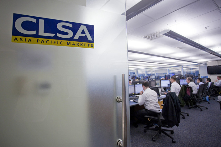The CLSA Asia-Pacific Markets logo is displayed on a door at the company's offices in Hong Kong in July 2012. Photo: VCG