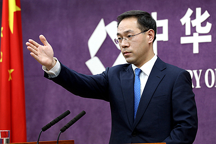 Gao Feng, spokesman of the Ministry of Commerce, takes questions from reporters on Thursday. Photo: Ministry of Commerce