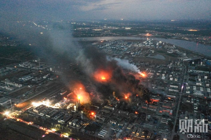 Flames were still visible at the site of the explosion in Xiangshui county, Jiangsu, 16 hours after the explosion on Thursday. Photo: Caixin