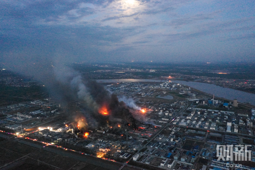 Heavy black, blue, and yellow smoke spews from a burning factory site in eastern China on Friday, in the wake of an explosion the previous day that has left at least 47 people dead and 90 badly injured. Photo: Caixin_Gallery: 47 Confirmed Dead in Jiangsu Chemical Plant Blast