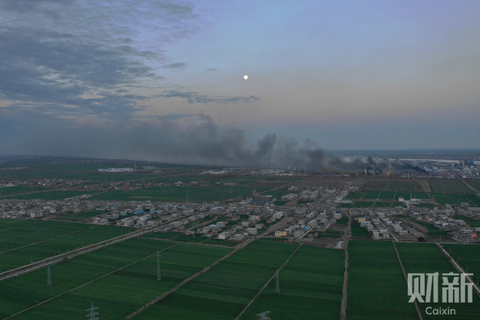 Smoke from the explosion could still be seen early Friday from the surrounding fields and residential areas in Xiangshui. Photo: Caixin