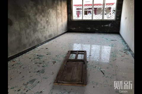 The explosion blew a door from its hinges in a building in Xiangshui. Photo: Caixin