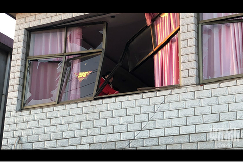The blast bent the window frames of one home in Xiangshui. Photo: Caixin