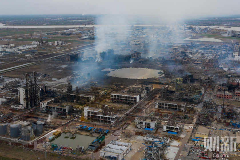 Smoke rises from the remains of the Jiangsu Tianjiayi Chemical plant on Saturday in Xiangshui county in East China's Jiangsu province.  Photo: Caixin_Gallery: 78 Confirmed Dead in Chemical Plant Explosion