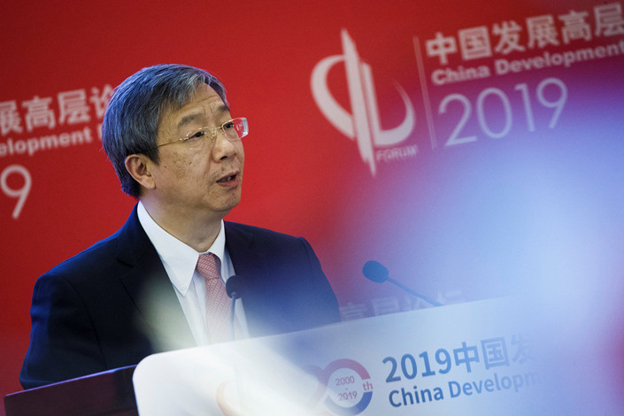 Central Bank Governor Yi Gang speaks at the China Development Forum in Beijing on Sunday. Photo: VCG